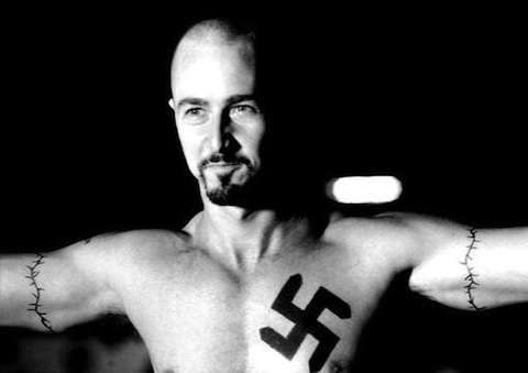 A swastika tattoo. Oh dear. Reputable sites often run disreputable adverts,