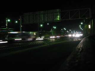 Coming over the bridge, the car lights blur together...
