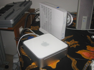 A comparison between my new Mac Mini and a Motorola SURFboard cable modem